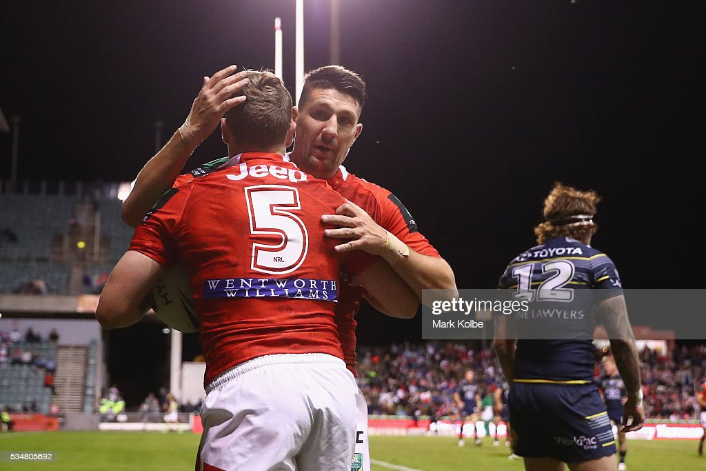 Kurt Mann and Gareth Widdop of the Dragons celebrate Kurt Mann scoring a try during the round 12 NRL match between the St George Illawarra Dragons and the North Queensland Cowboys at WIN Jubilee Stadium on May 28, 2016 in Wollongong, Australia.