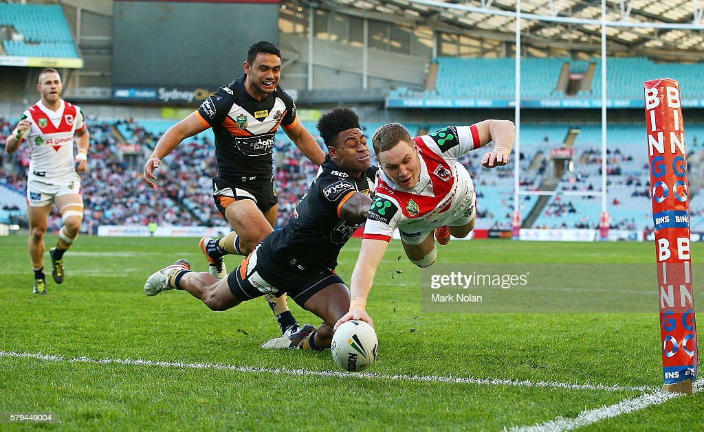 Kurt Mann of the Dragons dives to score a try during the round 20 NRL match between the St George Illawarra Dragons and the Wests Tigers at ANZ Stadium on July 24, 2016 in Sydney, Australia.