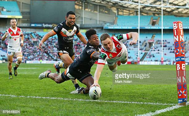 Kurt Mann of the Dragons dives to score a try during the round 20 NRL match between the St George Illawarra Dragons and the Wests Tigers at ANZ...
