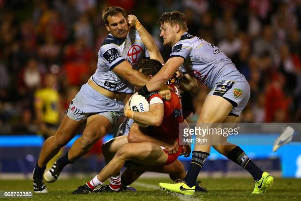 Kurt Mann of the Dragons is tackled during the round seven NRL match between the St George Illawarra Dragons and the North Queensland Cowboys at WIN...