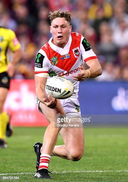 Kurt Mann of the Dragons passes the ball during the round 24 NRL match between the Brisbane Broncos and the St George Illawarra Dragons at Suncorp...