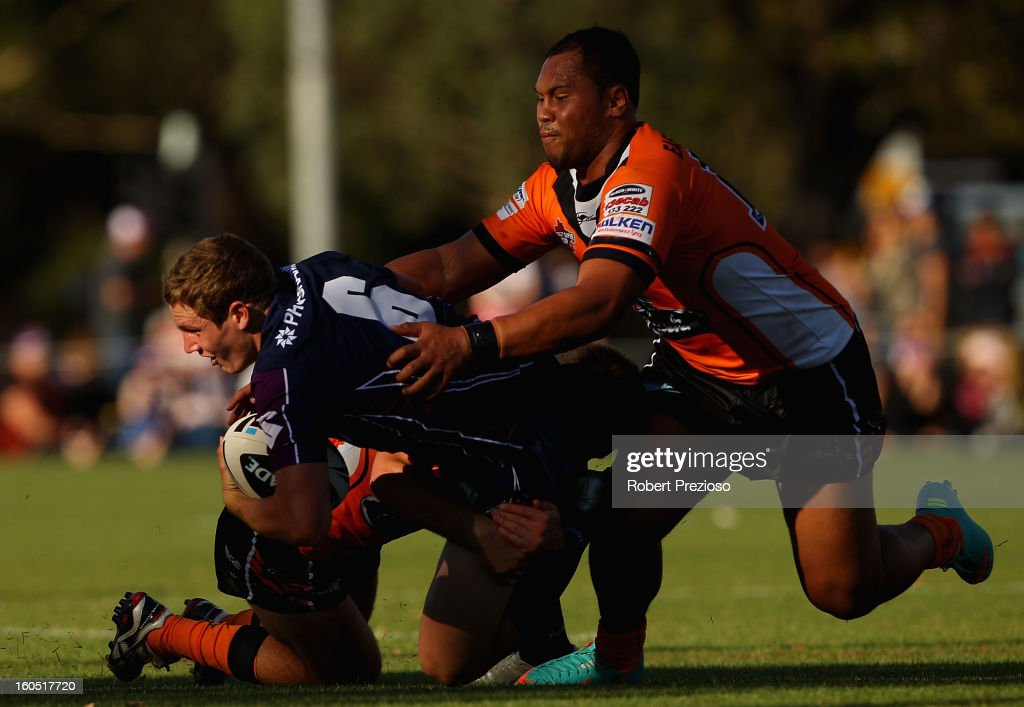 Kurt Mann of the Storm is tackled during the NRL trial match between the Melbourne Storm and Brisbane Easts at Gosch's Paddock on February 2, 2013 in Melbourne, Australia.