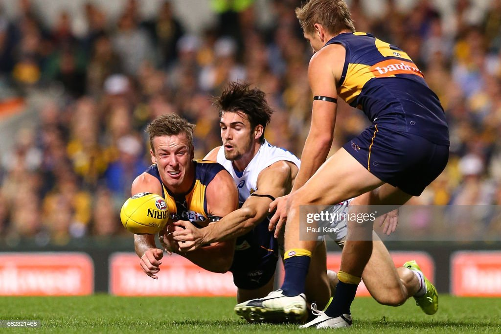 Kurt Mutimer of the Eagles handballs during the round eight AFL match between the West Coast Eagles and the Western Bulldogs at Domain Stadium on May 12, 2017 in Perth, Australia.