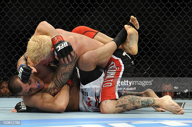 Kurt Pellegrino throws a right to the face of George Sotiropoulos of Australia during the UFC lightweight bout at the MGM Grand Garden Arena on July...