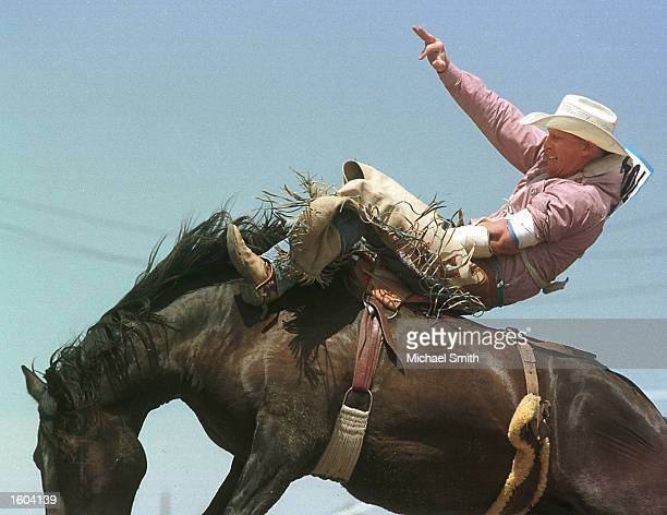 Kurt Radzay hangs on during the third round of the Bareback Bronc competition at the Cheyenne Frontier Days Rodeo July 26 2001 in Cheyenne WY Up to...