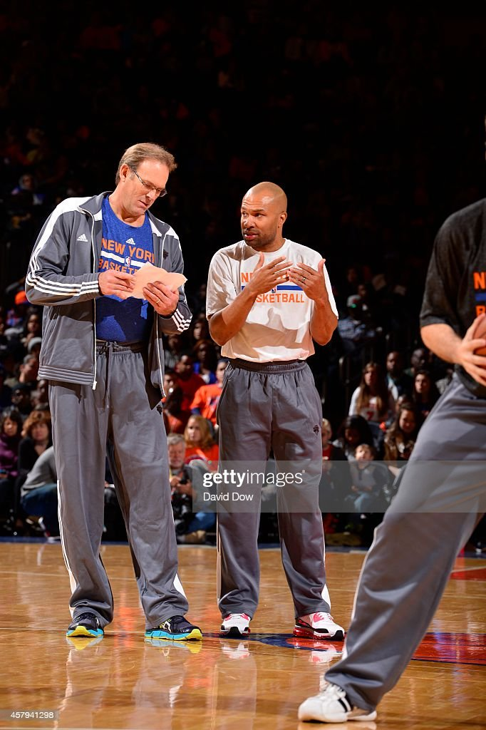 Kurt Rambis and Derek Fisher of the New York Knicks during open practice at Madison Square Garden on October 26 2014 in New York City New York NOTE...