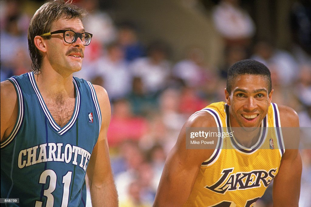 253706711a6 ... Kurt Rambis 31 of the Charlotte Hornets laughs with former teammate  Mychal Thompson 43 ...