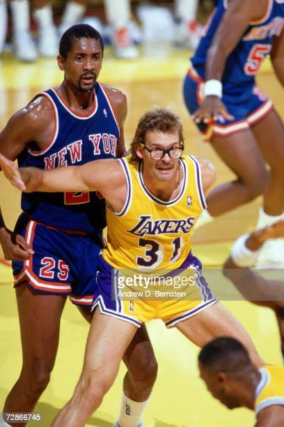 Kurt Rambis of the Los Angeles Lakers battles for position against the New York Knicks during a 1985 NBA game played at the Great Western Forum in...