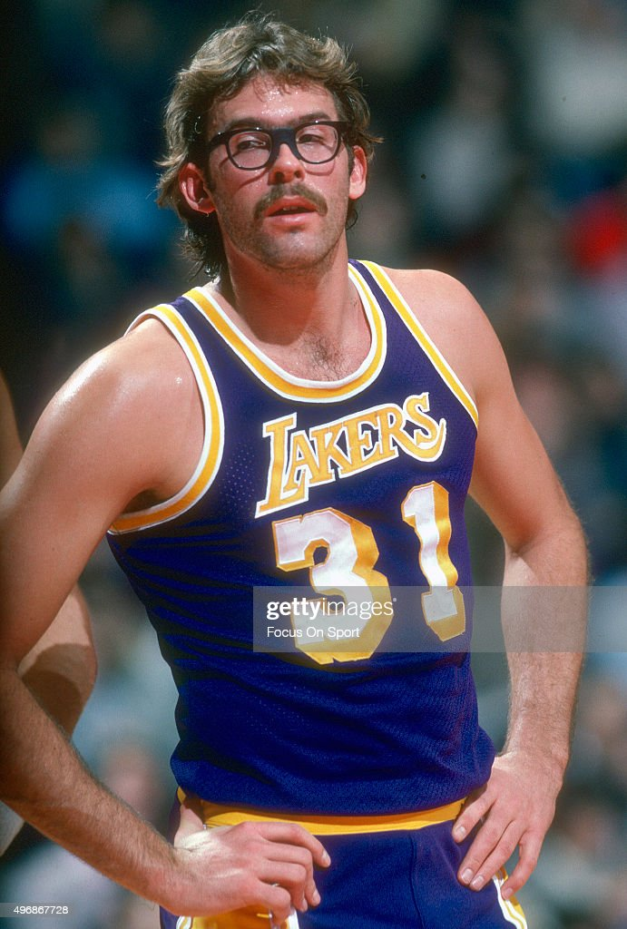 Kurt Rambis of the Los Angeles Lakers looks on against the Washington Bullets during an NBA basketball game circa 1981 at the Capital Centre in...