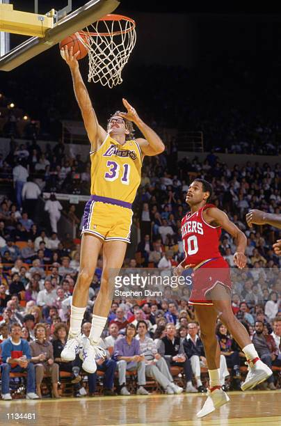 Kurt Rambis of the Los Angeles Lakers shoots a layup during an NBA game against the Philadelphia 76ers at the Great Western Forum in Los Angeles...