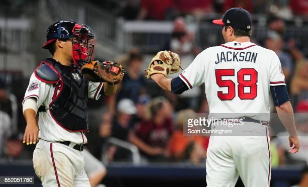 Kurt Suzuki and Luke Jackson of the Atlanta Braves celebrate after the game against the Philadelphia Phillies at SunTrust Park on September 22 2017...