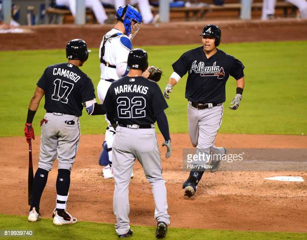 Kurt Suzuki of the Atlanta Braves celebrates his two run homerun with Johan Camargo and Nick Markakis to take a 51 lead over the Los Angeles Dodgers...