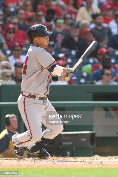 Kurt Suzuki of the Atlanta Braves single in the second inning to score Nick Markakis during a baseball game against the Washington Nationals at...
