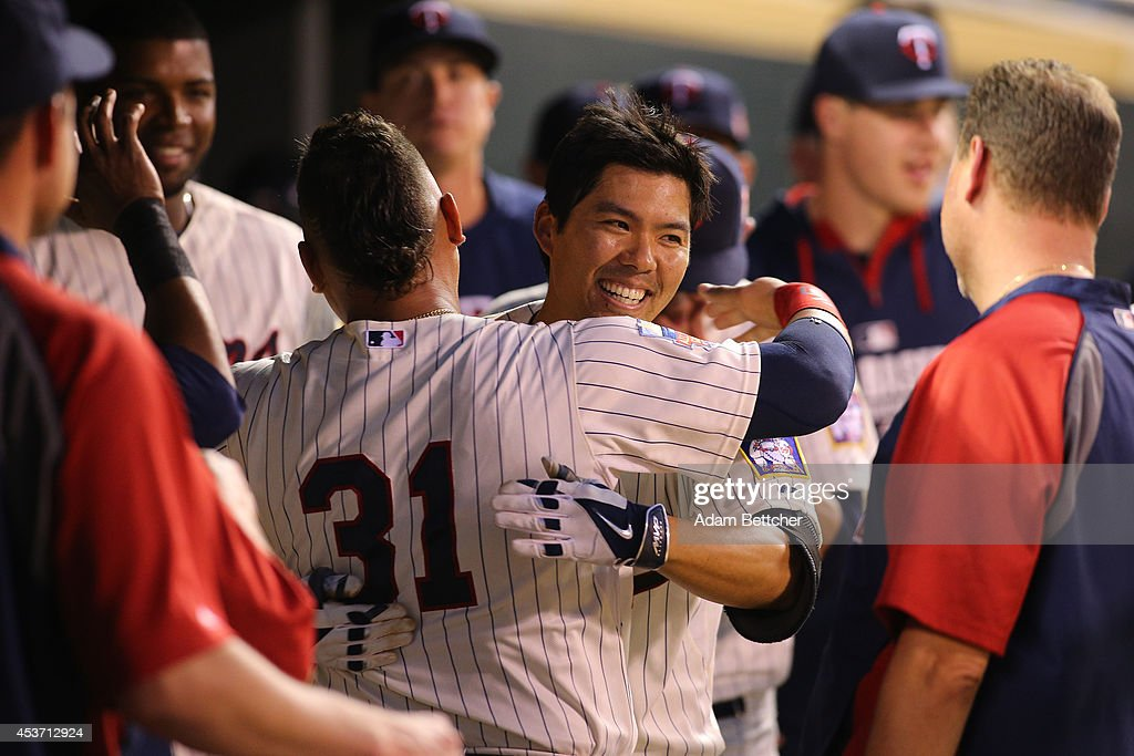<a gi-track='captionPersonalityLinkClicked' href=/galleries/search?phrase=Kurt+Suzuki&family=editorial&specificpeople=682702 ng-click='$event.stopPropagation()'>Kurt Suzuki</a> #8 of the Minnesota Twins celebrates with <a gi-track='captionPersonalityLinkClicked' href=/galleries/search?phrase=Oswaldo+Arcia&family=editorial&specificpeople=8948415 ng-click='$event.stopPropagation()'>Oswaldo Arcia</a> #31 of the Minnesota Twins after a home run against the Kansas City Royals at Target Field on August 16, 2014 in Minneapolis, Minnesota.