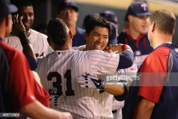 Kurt Suzuki of the Minnesota Twins celebrates with Oswaldo Arcia of the Minnesota Twins after a home run against the Kansas City Royals at Target...