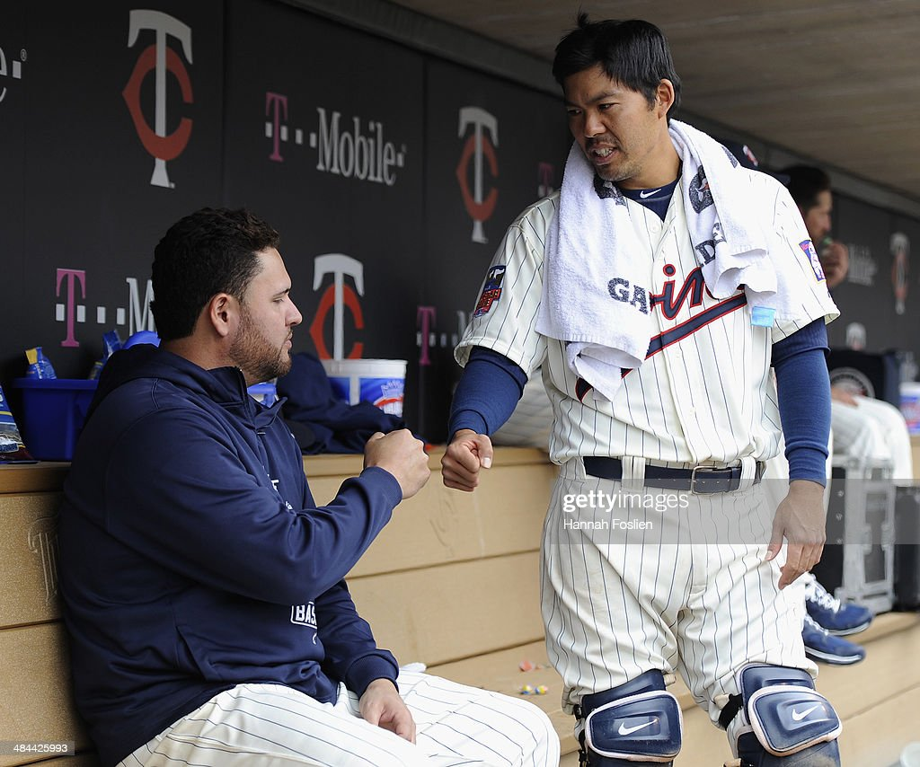 <a gi-track='captionPersonalityLinkClicked' href=/galleries/search?phrase=Kurt+Suzuki&family=editorial&specificpeople=682702 ng-click='$event.stopPropagation()'>Kurt Suzuki</a> #8 of the Minnesota Twins congratulates teammate <a gi-track='captionPersonalityLinkClicked' href=/galleries/search?phrase=Ricky+Nolasco&family=editorial&specificpeople=600111 ng-click='$event.stopPropagation()'>Ricky Nolasco</a> #47 during the eighth inning of the game against the Kansas City Royals on April 12, 2014 at Target Field in Minneapolis, Minnesota. The Twins defeated the Royals 7-1.