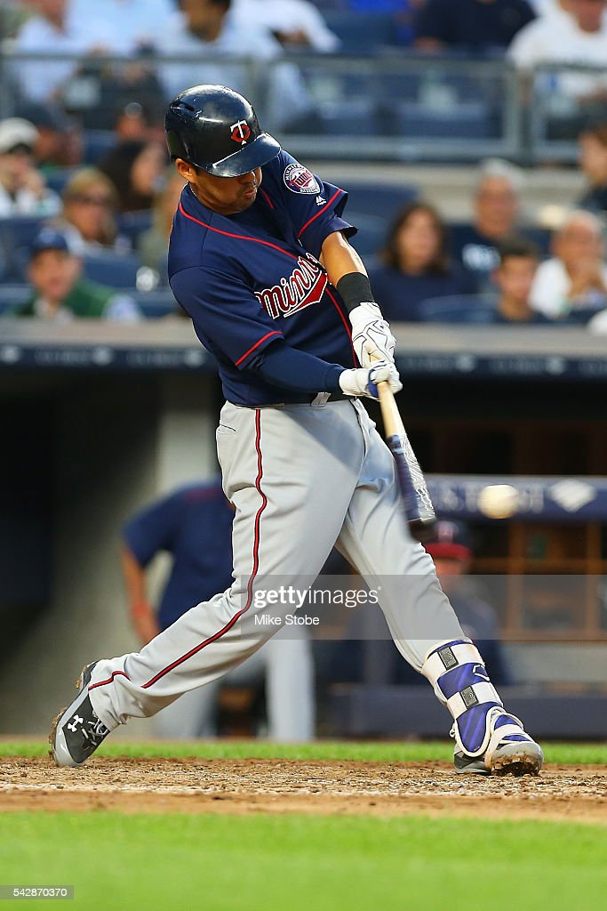 <a gi-track='captionPersonalityLinkClicked' href=/galleries/search?phrase=Kurt+Suzuki&family=editorial&specificpeople=682702 ng-click='$event.stopPropagation()'>Kurt Suzuki</a> #8 of the Minnesota Twins doubles to left in the fourth inning against the New York Yankees at Yankee Stadium on June 24, 2016 in the Bronx borough of New York City. Boston