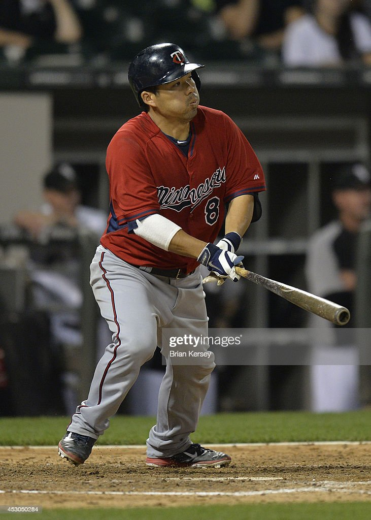 <a gi-track='captionPersonalityLinkClicked' href=/galleries/search?phrase=Kurt+Suzuki&family=editorial&specificpeople=682702 ng-click='$event.stopPropagation()'>Kurt Suzuki</a> #8 of the Minnesota Twins hits an RBI single scoring teammate Brian Dozier during the seventh inning against the Chicago White Sox at U.S. Cellular Field on August 1, 2014 in Chicago, Illinois.