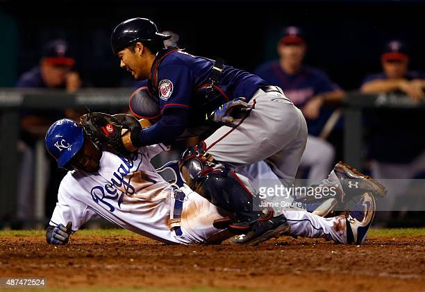 Kurt Suzuki of the Minnesota Twins tags out Jarrod Dyson of the Kansas City Royals at home plate while Dyson tries to score during the 10th inning of...
