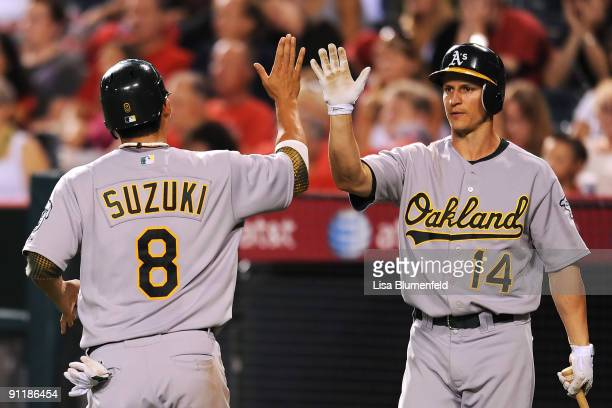 Kurt Suzuki of the Oakland Athletics scores in the 8th inning against the Los Angeles Angels of Anaheim at Angel Stadium of Anaheim on September 26...