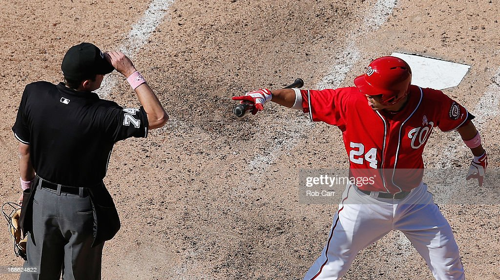 <a gi-track='captionPersonalityLinkClicked' href=/galleries/search?phrase=Kurt+Suzuki&family=editorial&specificpeople=682702 ng-click='$event.stopPropagation()'>Kurt Suzuki</a> #24 of the Washington Nationals argues with home plate umpire John Tumpane after being ejected in the ninth inning of the Nationals 2-1 loss to the Chicago Cubs at Nationals Park on May 12, 2013 in Washington, DC.