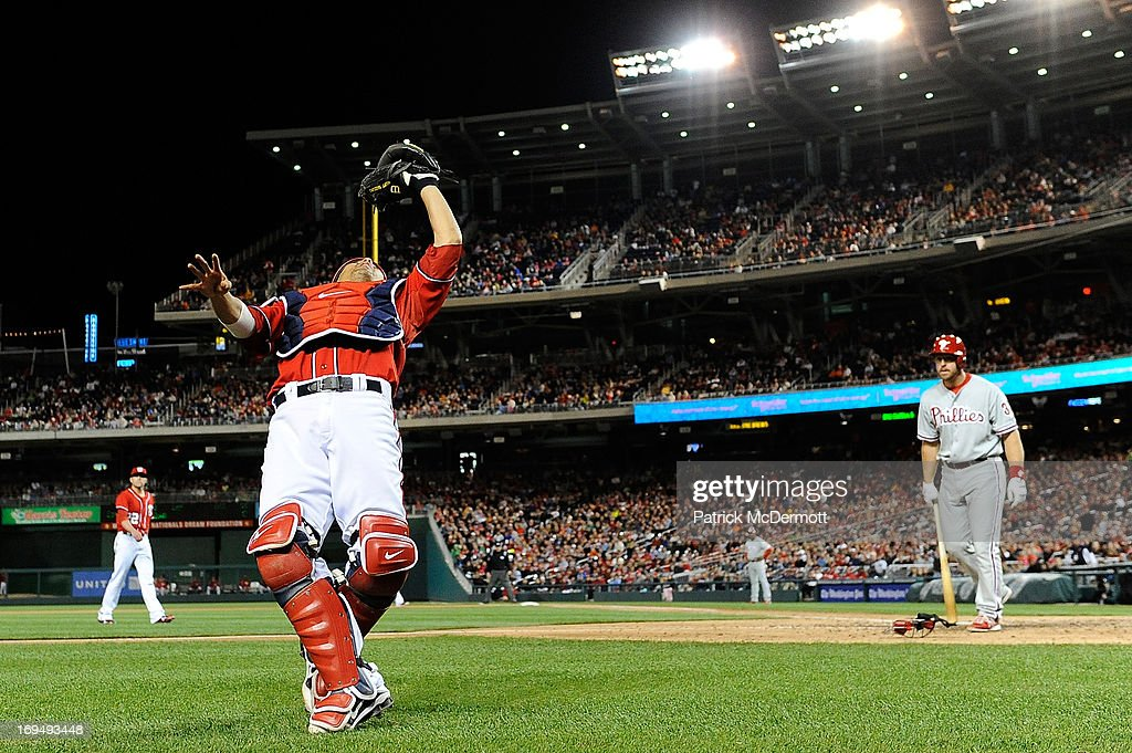 Kurt Suzuki #24 of the Washington Nationals catches a foul ball hit by Erik Kratz #31 of the Philadelphia Phillies to end the eighth inning of a game at Nationals Park on May 25, 2013 in Washington, DC.