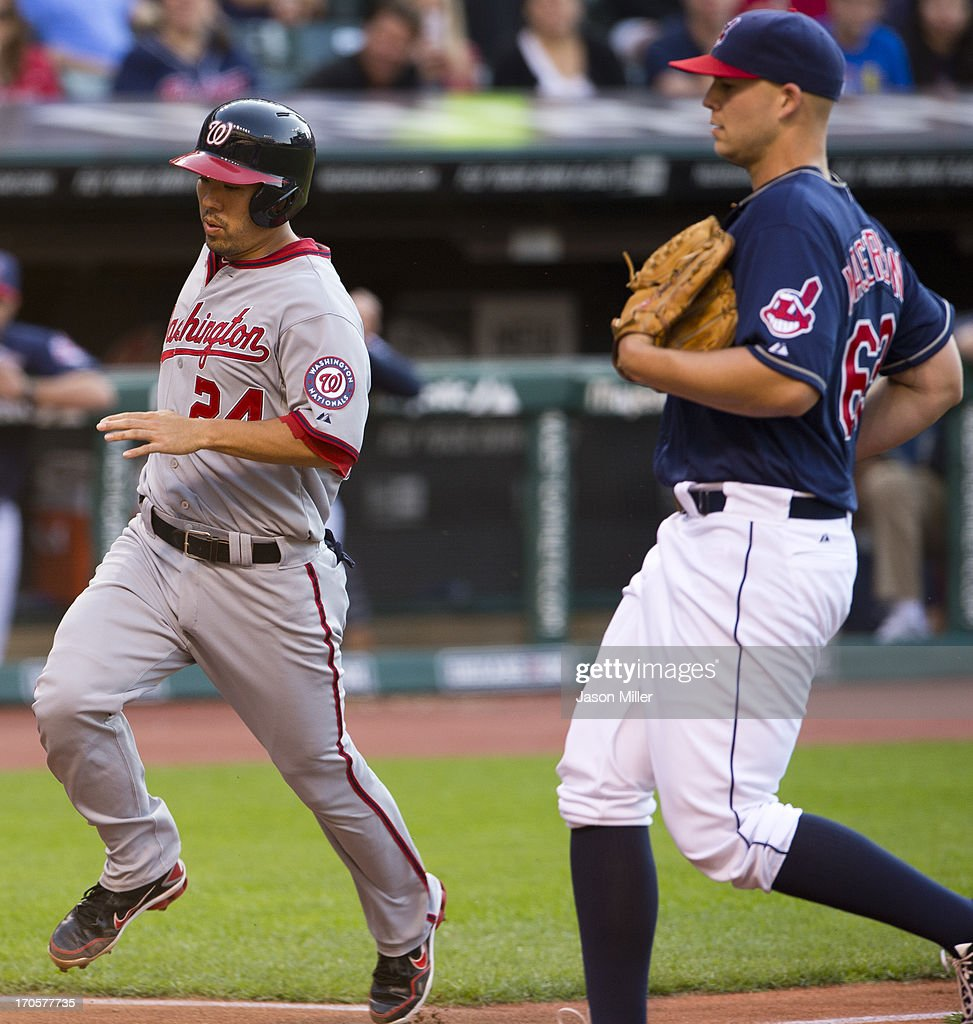 <a gi-track='captionPersonalityLinkClicked' href=/galleries/search?phrase=Kurt+Suzuki&family=editorial&specificpeople=682702 ng-click='$event.stopPropagation()'>Kurt Suzuki</a> #24 of the Washington Nationals scores on a passed ball thrown by starting pitcher <a gi-track='captionPersonalityLinkClicked' href=/galleries/search?phrase=Justin+Masterson&family=editorial&specificpeople=4950538 ng-click='$event.stopPropagation()'>Justin Masterson</a> #63 of the Cleveland Indians during the third inning at Progressive Field on June 14, 2013 in Cleveland, Ohio.