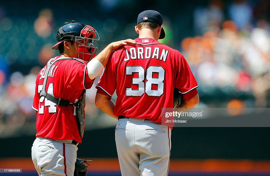 <a gi-track='captionPersonalityLinkClicked' href=/galleries/search?phrase=Kurt+Suzuki&family=editorial&specificpeople=682702 ng-click='$event.stopPropagation()'>Kurt Suzuki</a> #24 of the Washington Nationals talks with teammate Taylor Jordan #38 in a game against the New York Mets at Citi Field on June 29, 2013 in the Flushing neighborhood of the Queens borough of New York City. The game marks the major league debut for Jordan.