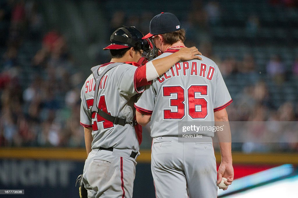 <a gi-track='captionPersonalityLinkClicked' href=/galleries/search?phrase=Kurt+Suzuki&family=editorial&specificpeople=682702 ng-click='$event.stopPropagation()'>Kurt Suzuki</a> #24 of the Washington Nationals talks with Tyler Clippard #36 of the Washington Nationals during the seventh inning at Turner Field on April 29, 2013 in Atlanta, Georgia. The Braves defeated the Nationals 3-2.