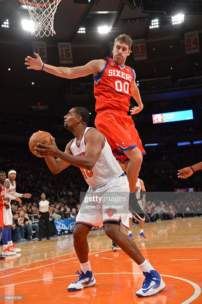 Kurt Thomas #40 of the New York Knicks fakes a shot against Spencer Hawes #00 of the Philadelphia 76ers on November 4, 2012 at Madison Square Garden in New York City.