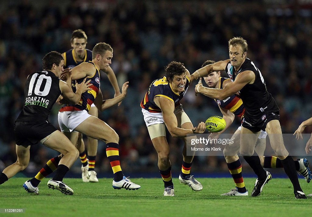 Kurt Tippett of the Crows and Dean Brogan of the Power competes for the ball during the round four AFL match between the Port Adelaide Power and the...