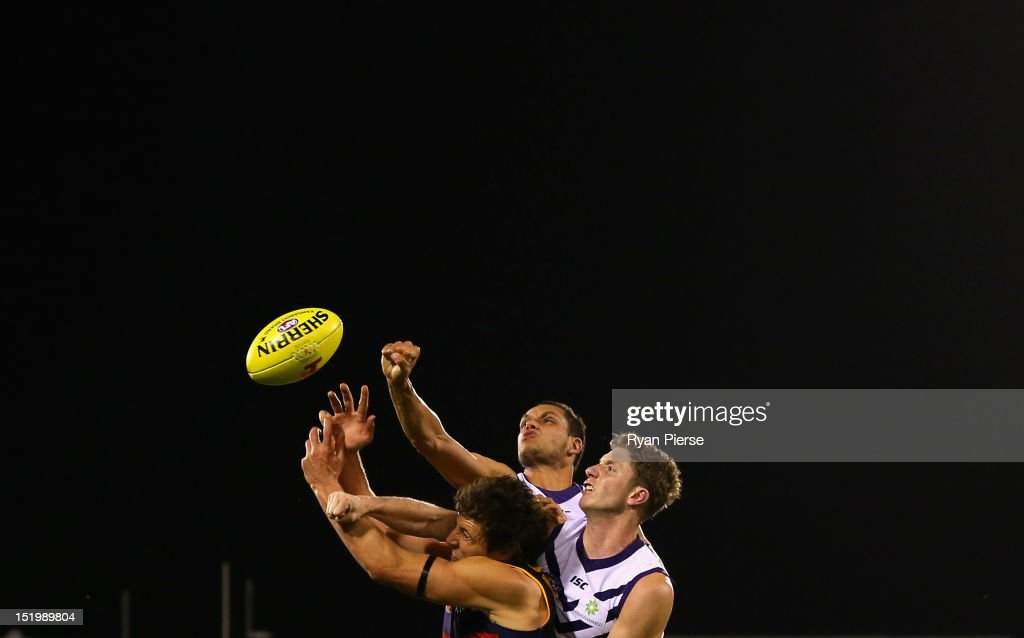 Kurt Tippett of the Crows contests the ball against Michael Johnson of the Dockers and Zac Dawson of the Dockers during the AFL Second Semi Final match between the Adelaide Crows and the Fremantle Dockers at AAMI Stadium on September 14, 2012 in Adelaide, Australia.