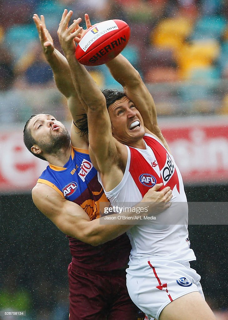 Kurt Tippett of the Swans contests a mark with Stefan Martin of the Lions during the round six AFL match between the Brisbane Lions and the Sydney Swans at The Gabba on May 1, 2016 in Brisbane, Australia.