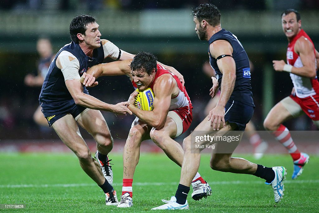<a gi-track='captionPersonalityLinkClicked' href=/galleries/search?phrase=Kurt+Tippett&family=editorial&specificpeople=779177 ng-click='$event.stopPropagation()'>Kurt Tippett</a> of the Swans is challenged by Michael Jamison of the Blues during the round 14 AFL match between the Sydney Swans and the Carlton Blues at SCG on June 28, 2013 in Sydney, Australia.