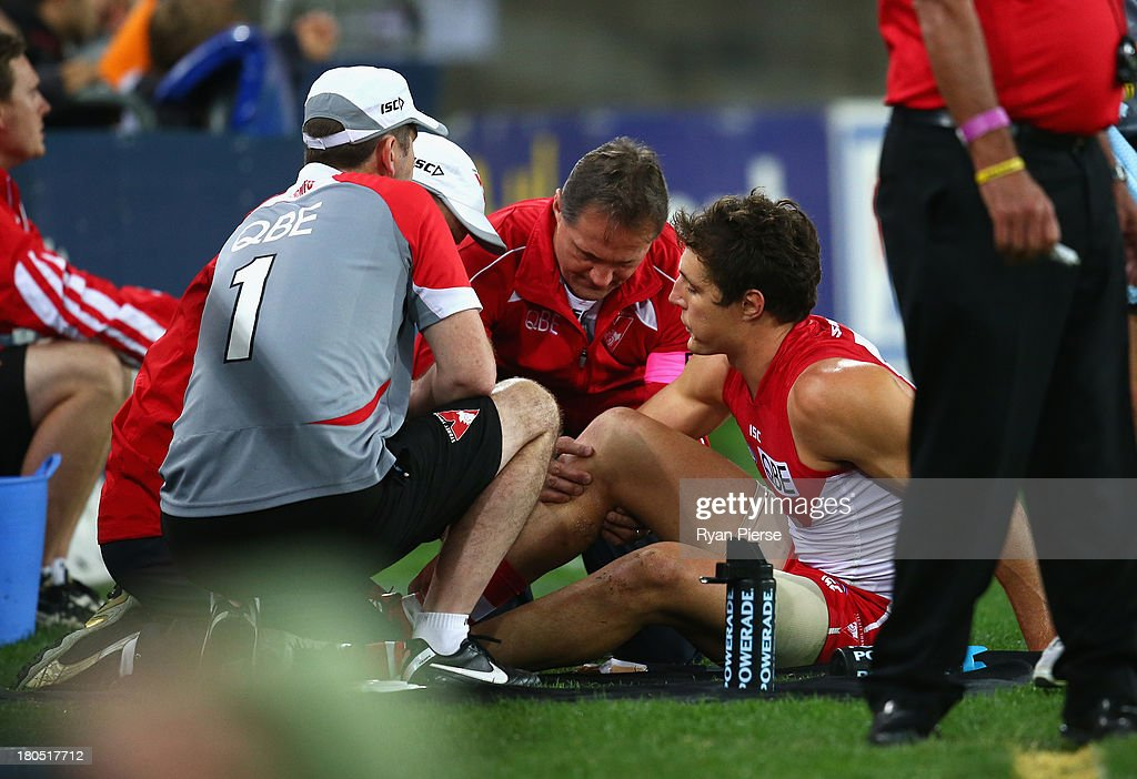 <a gi-track='captionPersonalityLinkClicked' href=/galleries/search?phrase=Kurt+Tippett&family=editorial&specificpeople=779177 ng-click='$event.stopPropagation()'>Kurt Tippett</a> of the Swans is treated for a leg injury during the AFL First Semi Final match between the Sydney Swans and the Carlton Blues at ANZ Stadium on September 14, 2013 in Sydney, Australia.
