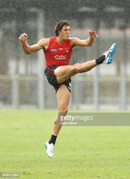 Kurt Tippett of the Swans kicks during a Sydney Swans AFL training session at Lakeside Oval on March 1 2017 in Sydney Australia