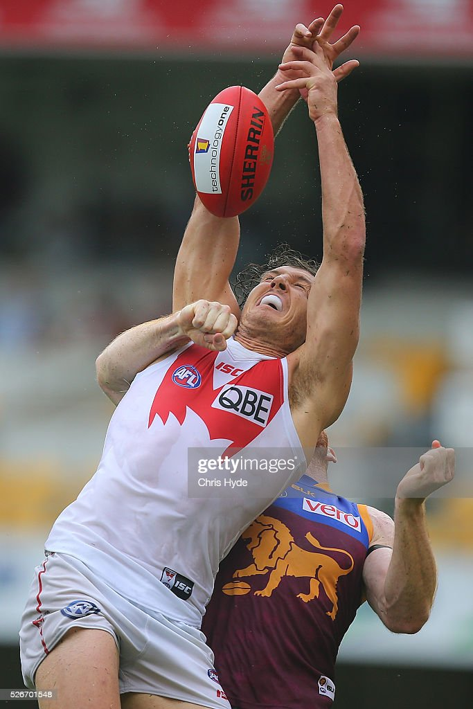 Kurt Tippett of the Swans takes a mark over Daniel Merrett of the Lions during the round six AFL match between the Brisbane Lions and the Sydney Swans at The Gabba on May 1, 2016 in Brisbane, Australia.