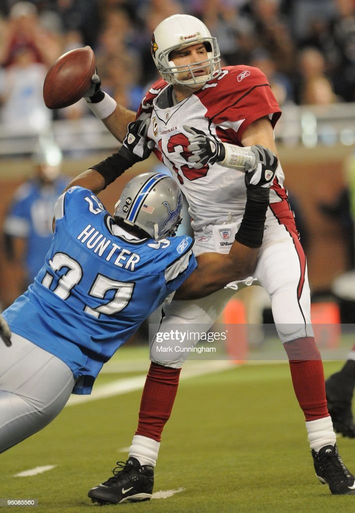 Kurt Warner of the Arizona Cardinals looks to throw a pass while being pursued by Jason Hunter of the Detroit Lions at Ford Field on December 20 2009...