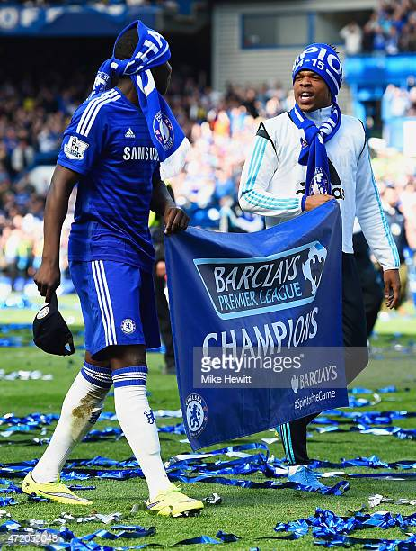 Kurt Zouma and Loic Remy of Chelsea celebrate winning the Premier League title after the Barclays Premier League match between Chelsea and Crystal...