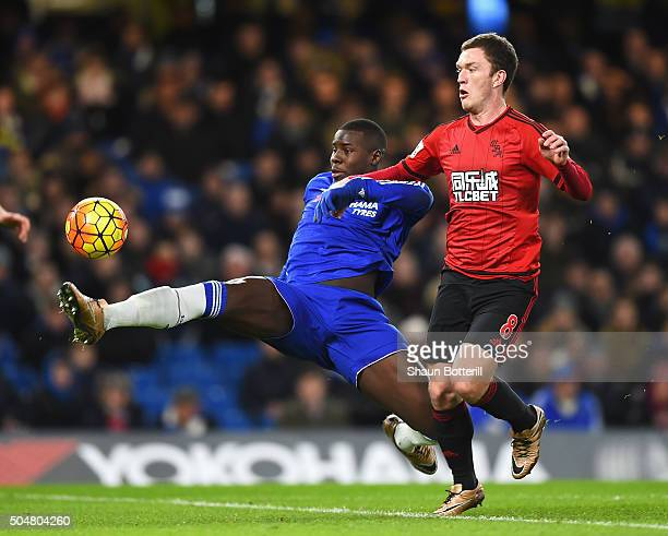 Kurt Zouma of Chelsea and Craig Gardner of West Bromwich Albion compete for the ball during the Barclays Premier League match between Chelsea and...