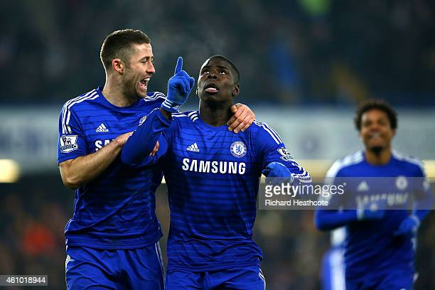 Kurt Zouma of Chelsea celebrates with Gary Cahill as he scores their third goal during the FA Cup Third Round match between Chelsea and Watford at...