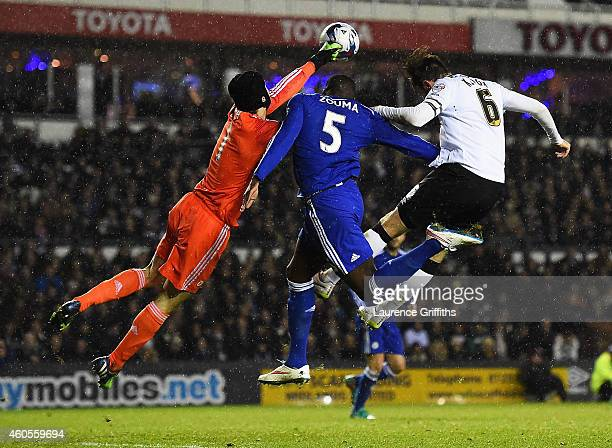 Kurt Zouma of Chelsea collides with goalkeeper Petr Cech of Chelsea and Richard Keogh of Derby during the Capital One Cup QuarterFinal match between...