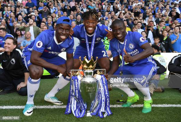 Kurt Zouma of Chelsea Michy Batshuayi of Chelsea and N'Golo Kante of Chelsea pose with the Preimer League Trophy after the Premier League match...