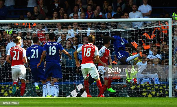 Kurt Zouma of Chelsea scores his team's first goal during the Barclays Premier League match between Chelsea and Arsenal at Stamford Bridge on...