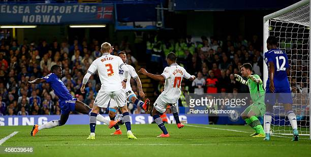 Kurt Zouma of Chelsea scores the first goal during the Captial One Cup Third Round match between Chelsea and Bolton Wanderers at Stamford Bridge on...