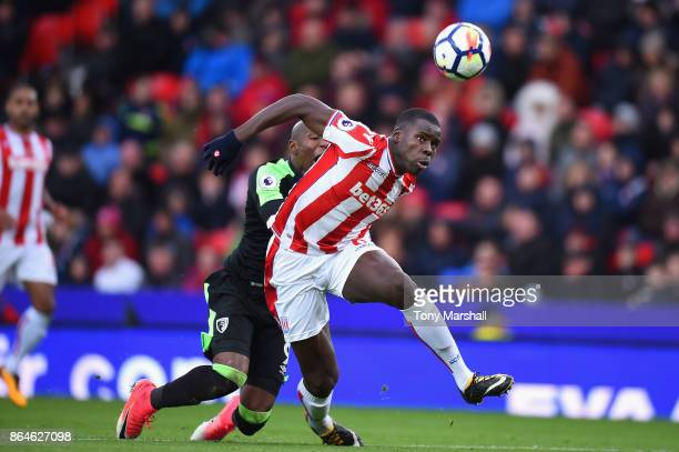 Kurt Zouma of Stoke City and Benik Afobe of AFC Bournemouth in action during the Premier League match between Stoke City and AFC Bournemouth at...