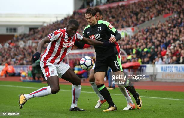 Kurt Zouma of Stoke City and Charlie Daniels of AFC Bournemouth during the Premier League match between Stoke City and AFC Bournemouth at Bet365...