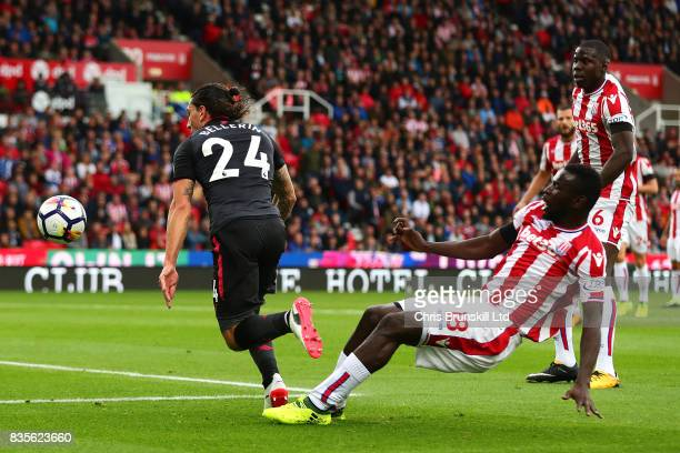 Kurt Zouma of Stoke City challenges Hector Bellerin of Arsenal during the Premier League match between Stoke City and Arsenal at Bet365 Stadium on...