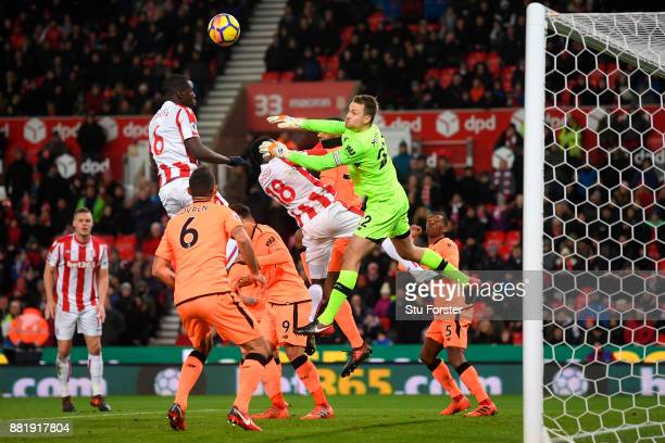 Kurt Zouma of Stoke City wins a header as Simon Mignolet of Liverpool attempts to punch during the Premier League match between Stoke City and...