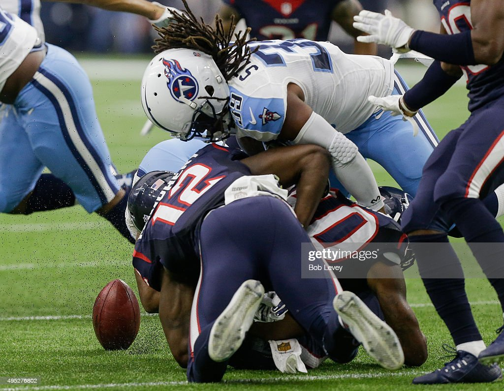 Kurtis Drummond #40 of the Houston Texans causes a fumble in the first half against the Tennessee Titans at NRG Stadium on November 1, 2015 in Houston, Texas.